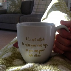 resting with mug on sofa